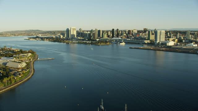 aerial sunlight harbor view san diego bay marina - san diego stock videos & royalty-free footage