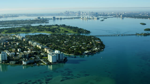 aerial sunrise bal harbour broad causeway condominium resort - biscayne bay stock videos & royalty-free footage