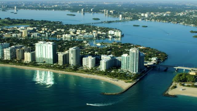 aerial sunrise bal harbour condominium resort biscayne bay - biscayne bay stock videos & royalty-free footage