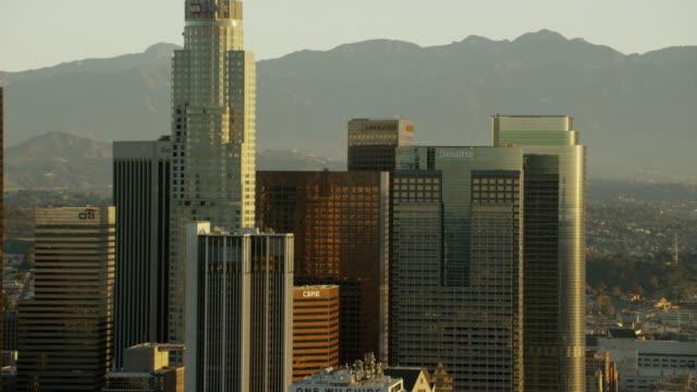 aerial sunrise bank of america building los angeles - financial building stock videos & royalty-free footage
