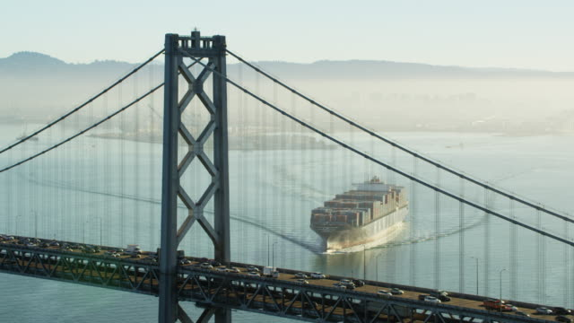 aerial sunrise bay bridge view san francisco california - ship stock videos & royalty-free footage