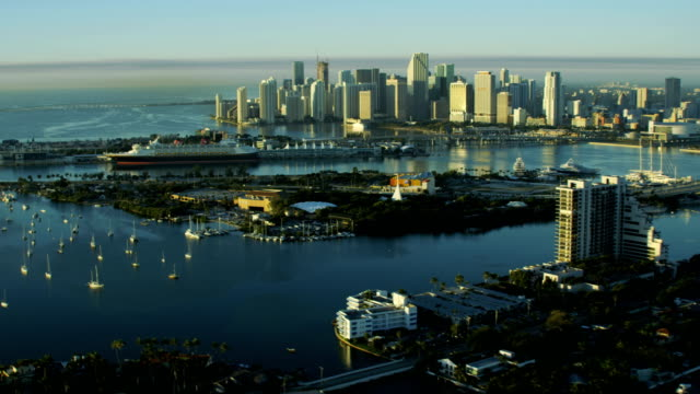 aerial sunrise biscayne island causeway cruise terminal miami - baia di biscayne video stock e b–roll