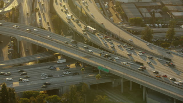 aerial sunrise busy freeway transport system los angeles - american interstate stock videos & royalty-free footage