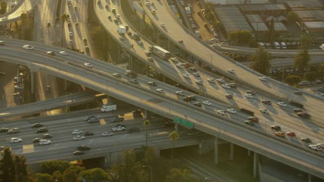 aerial sunrise busy freeway transport system los angeles - 主要道路点の映像素材/bロール