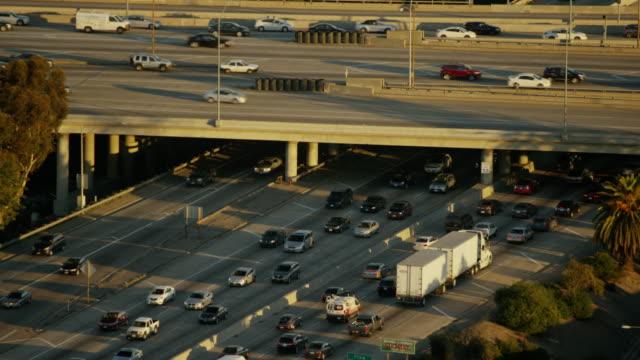 Aerial sunrise busy freeway transport system Los Angeles