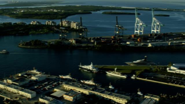 vidéos et rushes de aerial sunrise container port cruise terminal florida usa - biscayne bay