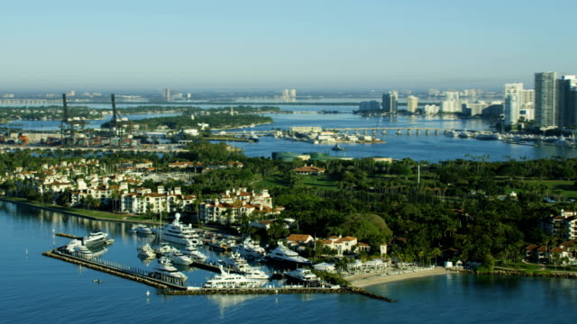 aerial sunrise fisher island condominiums miami beach florida - biscayne bay stock videos & royalty-free footage