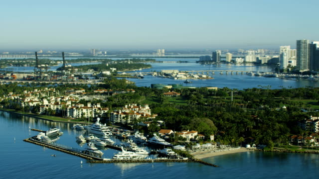 aerial sunrise fisher island luxury condominiums florida usa - biscayne bay stock videos & royalty-free footage