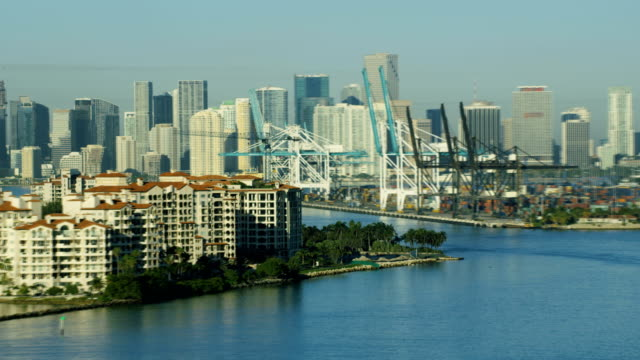 aerial sunrise fisher island luxury condominiums florida usa - biscayne bay stock videos & royalty-free footage