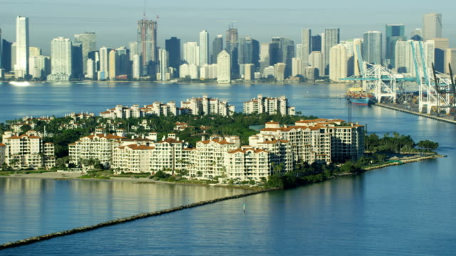 aerial sunrise fisher island luxury condominiums florida usa - biscayne bay stock-videos und b-roll-filmmaterial