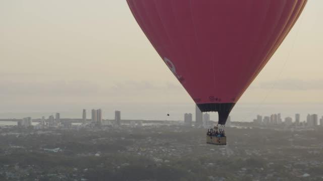 aerial sunrise hot air balloon city skyscrapers australia - tourist stock videos & royalty-free footage