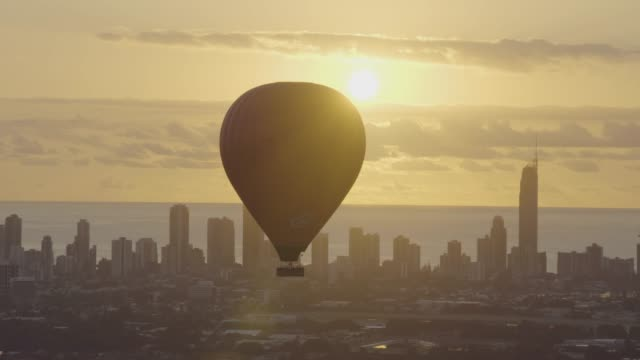 aerial sunrise hot air balloon city skyscrapers australia - queensland stock videos & royalty-free footage