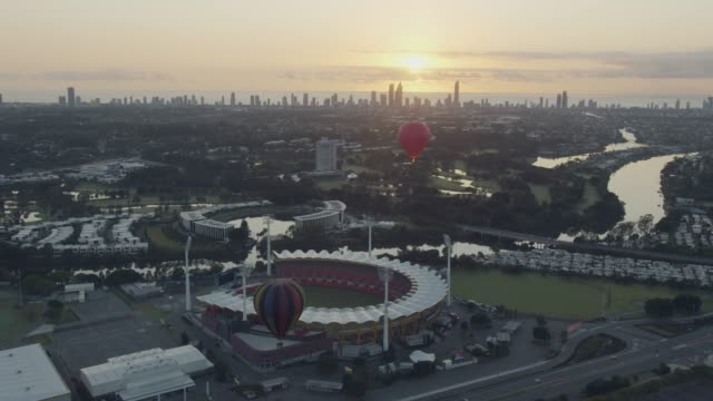 aerial sunrise hot air balloons city skyscrapers australia - queensland stock videos & royalty-free footage