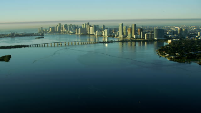 aerial sunrise julia tuttle causeway biscayne bay miami - biscayne bay stock videos and b-roll footage