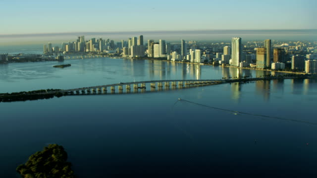 aerial sunrise julia tuttle causeway biscayne bay miami - biscayne bay stock videos & royalty-free footage