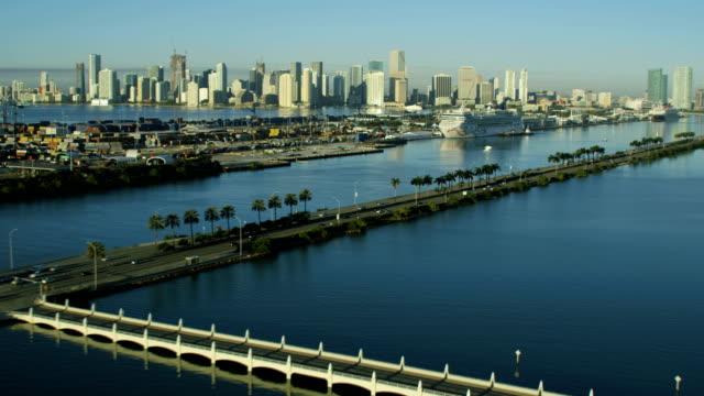 stockvideo's en b-roll-footage met aerial sunrise macarthur causeway and cruise terminal florida - biscayne bay
