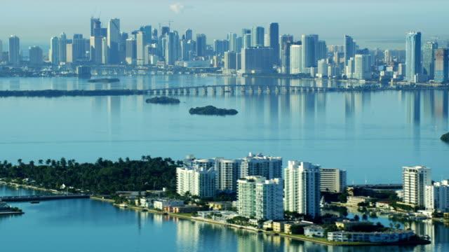 stockvideo's en b-roll-footage met aerial sunrise north bay island causeway city skyline - biscayne bay