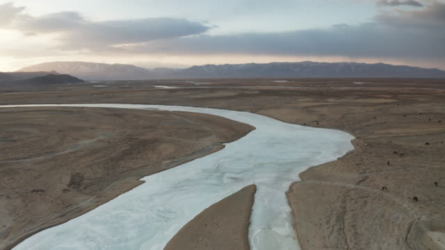 aerial sunrise over a frozen river hovd in western mongolia. - valley stock videos & royalty-free footage