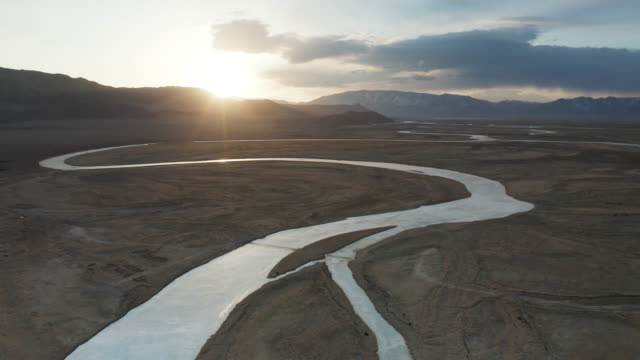 aerial sunrise over a frozen river hovd in western mongolia. - mongolia video stock e b–roll
