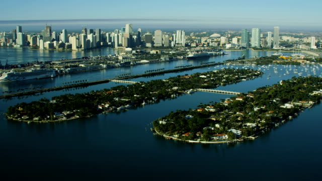 aerial sunrise palm islands biscayne bay condominiums florida - biscayne bay stock-videos und b-roll-filmmaterial