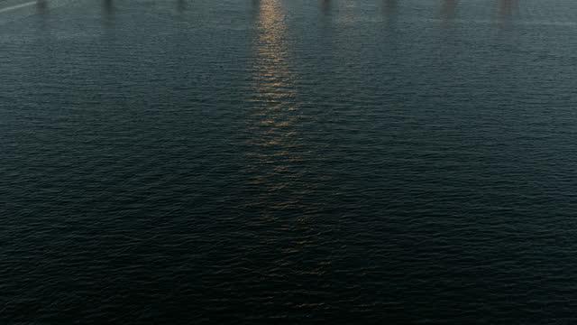 aerial sunrise reveal san diego bay coronado bridge - harbour stock videos & royalty-free footage