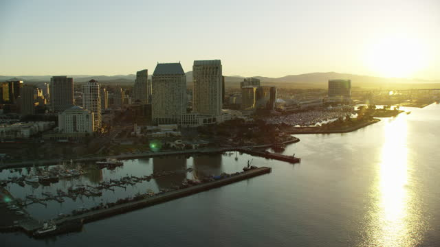 aerial sunrise san diego skyscrapers seaport village pier - harbour stock videos & royalty-free footage