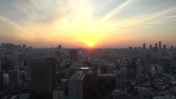 TOKYO, JAPAN : Aerial sunrise scenery of CITYSCAPE of TOKYO time lapse shot night to morning.