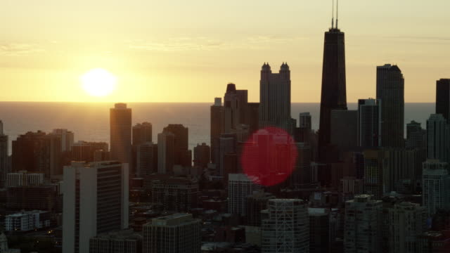 aerial sunrise silhouette of chicago city skyscrapers - michigan avenue chicago stock videos & royalty-free footage