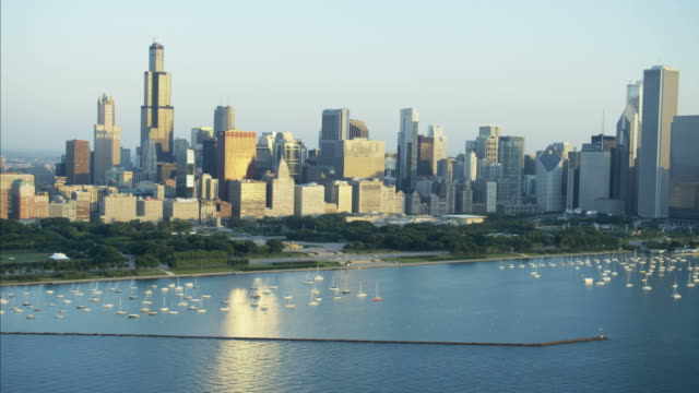 aerial sunrise skyline view lake michigan marina chicago - millennium park chicago stock videos and b-roll footage
