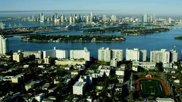 aerial sunrise star island city skyline biscayne bay - biscayne bay stock-videos und b-roll-filmmaterial