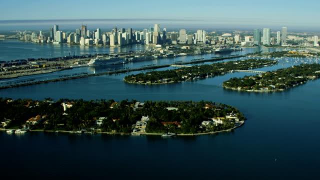aerial sunrise star island city skyline biscayne bay - star island stock videos & royalty-free footage