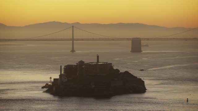 aerial sunrise the rock alcatraz island san francisco - アルカトラズ島点の映像素材/bロール