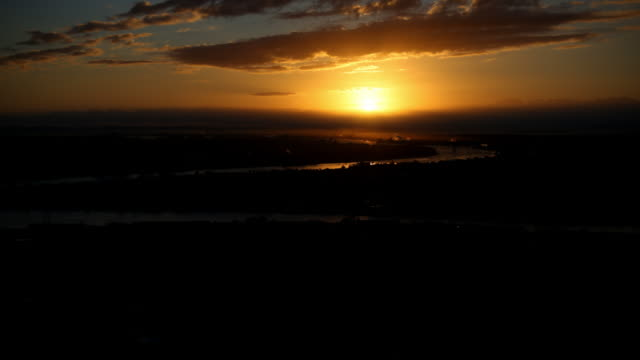 Aerial Sunrise Timelapse of Brisbane city with sea views