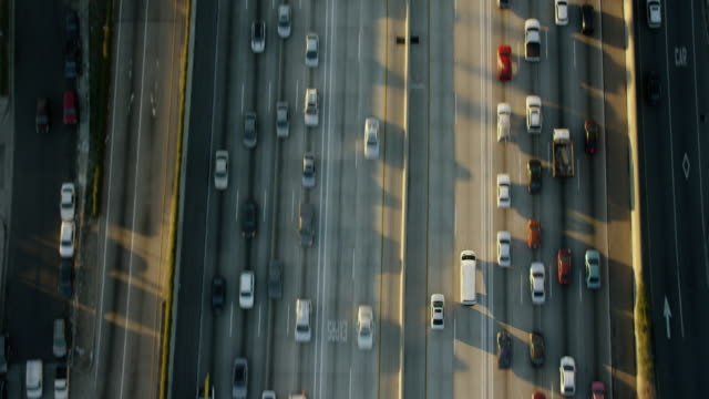 aerial sunrise vertical view freeway system los angeles - autostrada interstatale americana video stock e b–roll