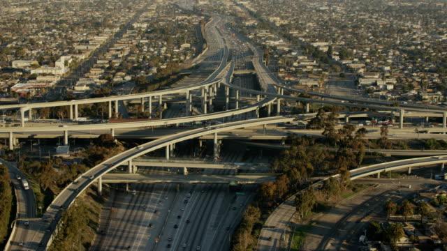 Aerial sunrise vertical view Los Angeles freeway flyover