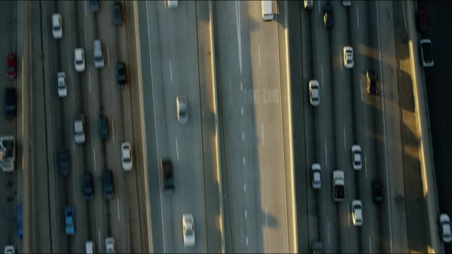 aerial sunrise view busy freeway system los angeles - american interstate stock videos & royalty-free footage