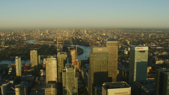 aerial sunrise view canary wharf and london cityscape - canary wharf stock videos & royalty-free footage