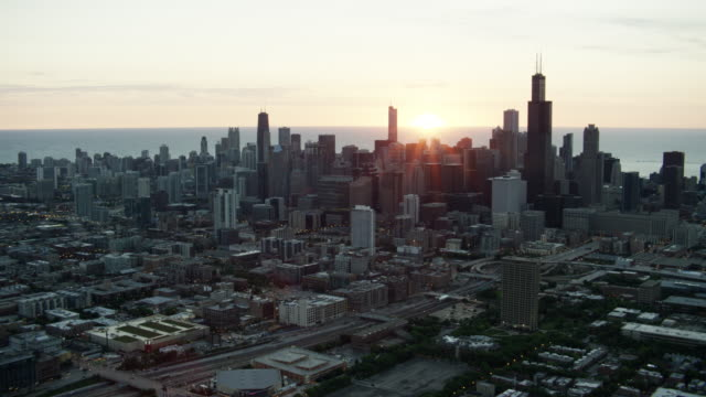 aerial sunrise view chicago downtown city buildings - aerial transport building stock videos & royalty-free footage