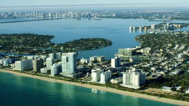 aerial sunrise view city skyline north beach miami - baia di biscayne video stock e b–roll