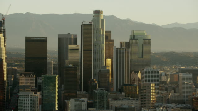 aerial sunrise view downtown skyscrapers los angeles california - financial building stock videos & royalty-free footage