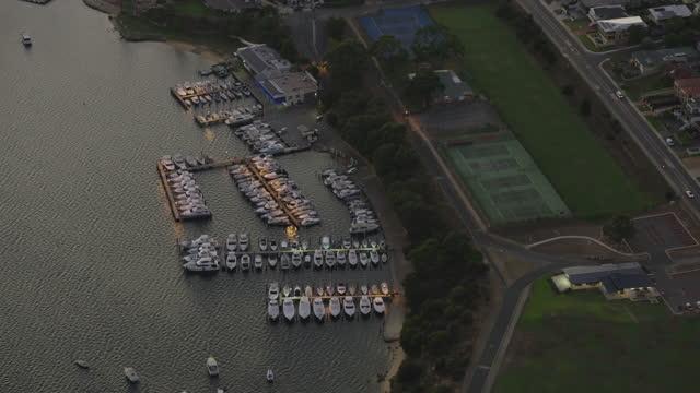 aerial sunrise view east fremantle yacht club perth - フリーマントル点の映像素材/bロール