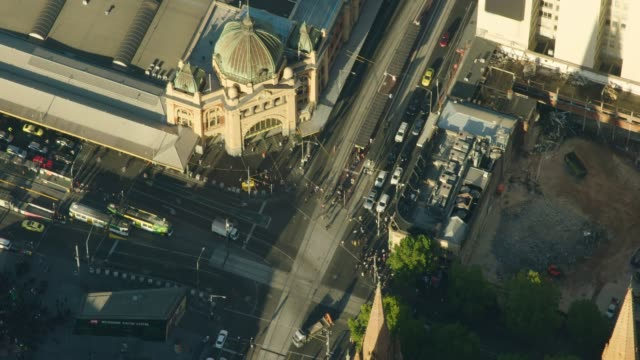 aerial sunrise view flinders street station entrance melbourne - tram stock videos & royalty-free footage