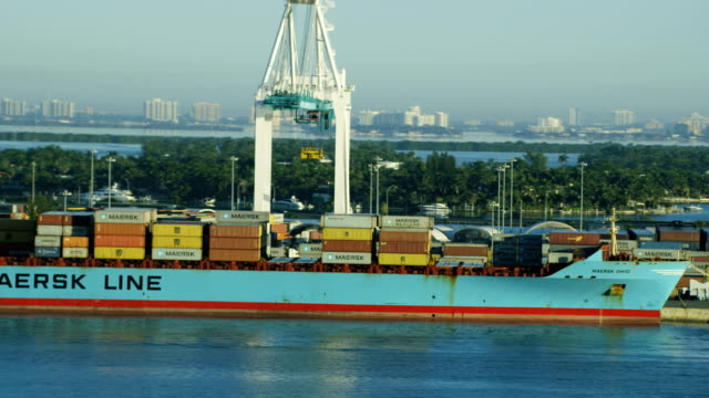 stockvideo's en b-roll-footage met aerial sunrise view global container shipping port miami - biscayne bay