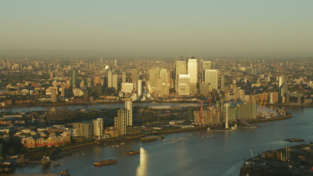 aerial sunrise view greenwich peninsula river thames london - peninsula stock videos and b-roll footage