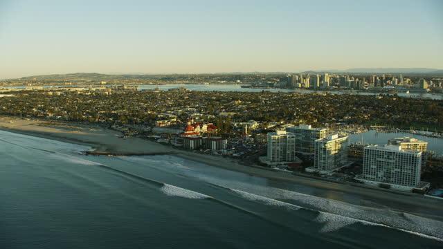 aerial sunrise view hotel coronado beach san diego - harbour stock videos & royalty-free footage