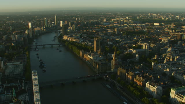 aerial sunrise view houses of parliament london uk - westminster bridge stock-videos und b-roll-filmmaterial