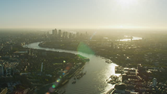 aerial sunrise view london city skyline canary wharf - river thames stock videos & royalty-free footage