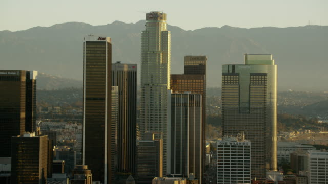 aerial sunrise view los angeles downtown financial buildings - financial building stock videos & royalty-free footage