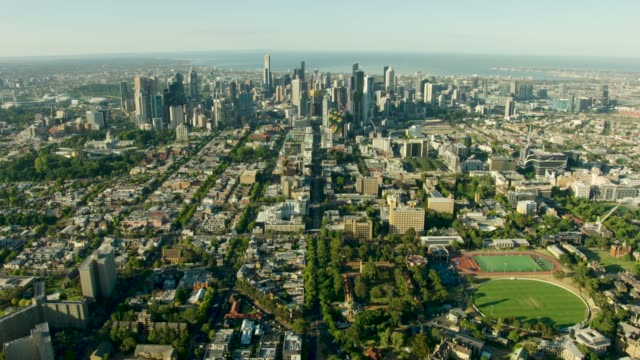 aerial sunrise view melbourne cbd skyline and university - economy stock videos & royalty-free footage