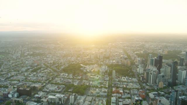 Aerial sunrise view Melbourne suburbs and Carlton Gardens